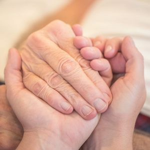 A square image of a healthcare professional providing end of life care
